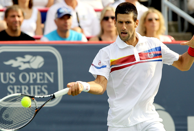 MONTREAL, QC - AUGUST 14:  Novak Djokovic of Serbia returns a shot to Mardy Fish of the United States during the final of the Rogers Cup at Uniprix Stadium on August 14, 2011 in Montreal, Quebec, Canada.  (Photo by Matthew Stockman/Getty Images)