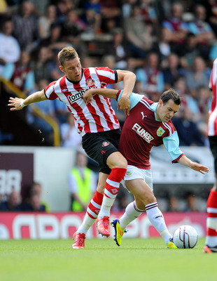 BURNLEY, UNITED KINGDOM - JULY 30: Connor Wickham of Sunderland (L) battles for the ball with Ross Wallace of Burnley during the pre season friendly match between Burnley and Sunderland at Turf Moor on July 30, 2011 in Burnley, England. (Photo by Clint Hu