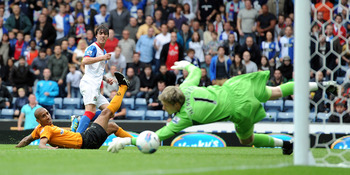 BLACKBURN, ENGLAND - AUGUST 13:  Mauro Formica of Blackburn Rovers scores the opening goal past Wayne Hennessey of Wolverhampton Wanderers during the Barclays Premier League match between Blackburn Rovers and Wolverhampton Wanderers at Ewood Park on Augus