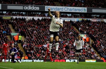 LIVERPOOL, ENGLAND - MAY 15:  Luka Modric of Spurs cedlebrates after scoring his team's second goal from the penalty spot during the Barclays Premier League match between Liverpool and Tottenham Hotspur at Anfield on May 15, 2011 in Liverpool, England.  (