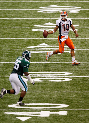NEW ORLEANS - NOVEMBER 07:  Quarterback Trevor Vittatoe #10 of the UTEP Miners looks to pass in front of Justin Adams #95 of the Tulane Green Wave at Louisana Superdome on November 7, 2009 in New Orleans, Louisiana.  (Photo by Ronald Martinez/Getty Images