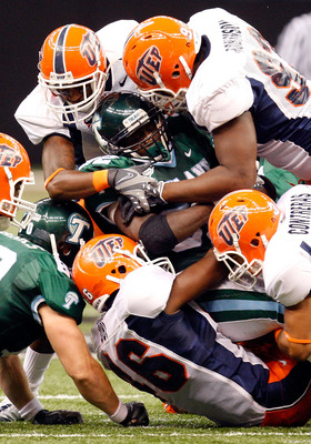 NEW ORLEANS - NOVEMBER 07:  Running back Andre Anderson #32 of the Tulane Green Wave is tackled by the UTEP Miners at Louisana Superdome on November 7, 2009 in New Orleans, Louisiana.  (Photo by Ronald Martinez/Getty Images)