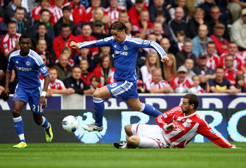 STOKE ON TRENT, ENGLAND - AUGUST 14:  Fernando Torres of Chelsea is challenged by Rory Delap of Stoke during the Barclays Premier League match between Stoke City and Chelsea at the Britannia Stadium on August 14, 2011 in Stoke on Trent, England.  (Photo b