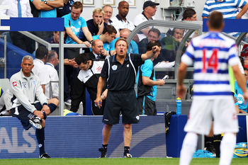 LONDON, ENGLAND - AUGUST 13:  Neil Warnock manager of Queens Park Rangers issues instructions to his players during the Barclays Premier League match between Queens Park Rangers and Bolton Wanderers at Loftus Road on August 13, 2011 in London, England.  (
