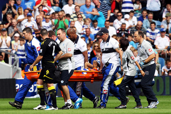 LONDON, ENGLAND - AUGUST 13:  Kieron Dyer of Queens Park Rangers is stretchered off during the Barclays Premier League match between Queens Park Rangers and Bolton Wanderers at Loftus Road on August 13, 2011 in London, England.  (Photo by Michael Steele/G