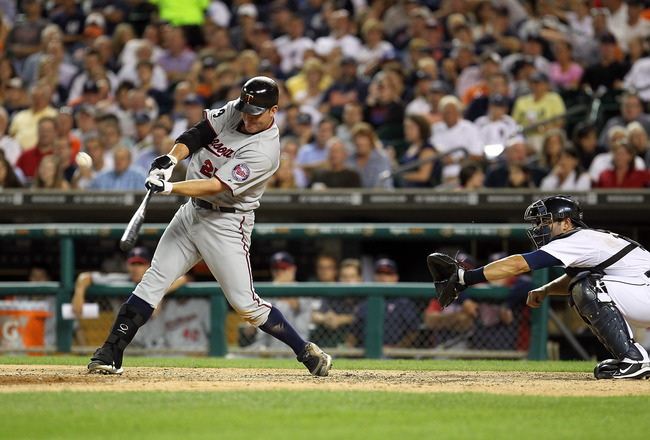 DETROIT, MI - AUGUST 15: DH, Jim Thome #25 of the Minnesota Twins hits his second home run of the game in the seventh inning and his 600th career home run making him only the eighth player in Major League Baseball history to achieve that milestone during