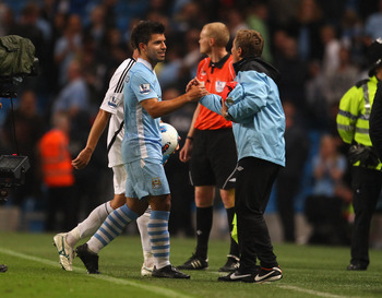 MANCHESTER, ENGLAND - AUGUST 15:  Sergio Aguero of Manchester City is congratulated after the Barclays Premier League match between Manchester City and Swansea City at Etihad Stadium on August 15, 2011 in Manchester, England.  (Photo by Alex Livesey/Getty