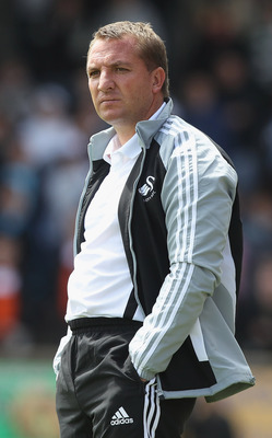 NEATH, WALES - JULY 16:  Brendan Rodgers, the Swansea City manager looks on during the pre season friendly match between Neath and Swansea City at the Knoll on July 16, 2011 in Neath, Wales.  (Photo by David Rogers/Getty Images)