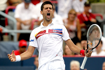 MONTREAL, QC - AUGUST 14:  Novak Djokovic of Serbia celebrates match point against Mardy Fish of the United States in the final of the Rogers Cup at Uniprix Stadium on August 14, 2011 in Montreal, Quebec, Canada.  (Photo by Matthew Stockman/Getty Images)