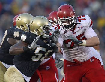 SOUTH BEND, IN - NOVEMBER 13: Prince Shembo #55 of the Notre Dame Fighting Irish rushes against John Cullen #75 of the Utah Utes at Notre Dame Stadium on November 13, 2010 in South Bend, Indiana. Notre Dame defeated Utah 28-3. (Photo by Jonathan Daniel/Ge