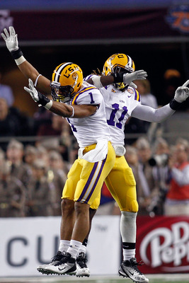 ARLINGTON, TX - JANUARY 07:  Eric Reid #1 and Kelvin Sheppard #11 of the Louisiana State University Tigers celebrate after an interception during the game against the Texas A&M Aggies during the AT&T Cotton Bowl at Cowboys Stadium on January 7, 2011 in Ar