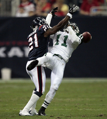 HOUSTON - AUGUST 15:  Cornerback Brice McCain #21 of the Houston Texans knocks the ball away from wide receiver Jeremy Kerley #11 of the New York Jets at Reliant Stadium on August 15, 2011 in Houston, Texas.  (Photo by Bob Levey/Getty Images)