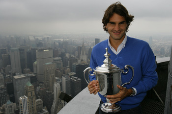 NEW YORK - SEPTEMBER 09:  Roger Federer the 2008 US Open Tennis Champion poses with his trophy on a viewing deck at the Empire State Building on September 9, 2008 in New York City.  (Photo by Chris Trotman/Getty Images for the USTA)