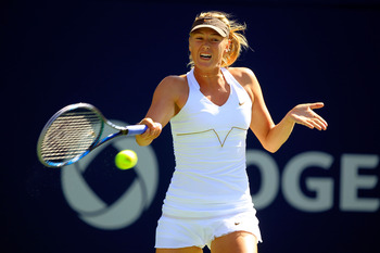 TORONTO, ON - AUGUST 11: Maria Sharapova of Russia returns to Galina Voskoboeva of Kazakhstan on Day 4 of the Rogers Cup presented by National Bank at the Rexall Centre on August 11, 2011 in Toronto, Ontario, Canada.  (Photo by Chris Trotman/Getty Images)