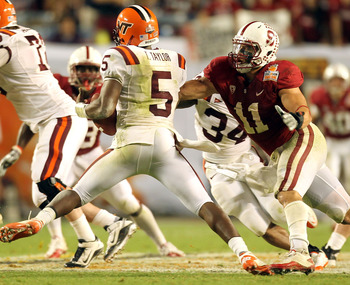 MIAMI, FL - JANUARY 03:  Shayne Skov #11 of the Stanford Cardinal chases down Tyrod Taylor #5 of the Virginai Tech Hokies during the 2011 Discover Orange Bowl at Sun Life Stadium on January 3, 2011 in Miami, Florida. Stanford won 40-12. (Photo by Mike Ehr