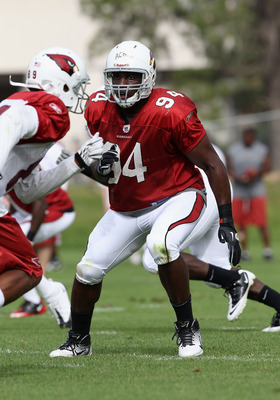 FLAGSTAFF, AZ - JULY 31:  Linebacker Sam Acho #94 of the Arizona Cardinals practices in the team training camp at Northern Arizona University on July 31, 2011 in Flagstaff, Arizona.  (Photo by Christian Petersen/Getty Images)