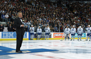 TORONTO - FEBRUARY 8:  Darryl Sittler is honored at center ice with the raising of a banner with his number 27 before a game between the Montreal Cananiens and The Toronto Maple Leafs at Air Canada Centre on February 8, 2003 in Toronto, Ontario. The Maple