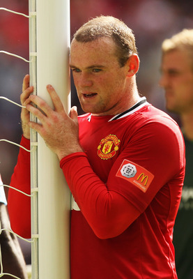 LONDON, ENGLAND - AUGUST 07:  Wayne Rooney of Manchester United looks on during the FA Community Shield match sponsored by McDonald's between Manchester City and Manchester United at Wembley Stadium on August 7, 2011 in London, England.  (Photo by Ian Wal