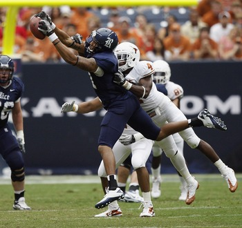 HOUSTON - SEPTEMBER 04:  Wide receiver Pierre Beasley #11 of the Rice Owls makes a catch in front of cornerback Aaron Williams #4 of the Texas Longhorns at Reliant Stadium on September 4, 2010 in Houston, Texas.  (Photo by Bob Levey/Getty Images)