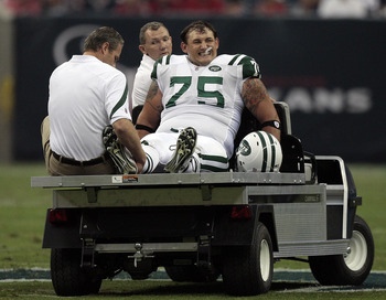 HOUSTON - AUGUST 15:  Offensive lineman Robert Turner #75 of the New York Jets is carted off the field after suffering an injury during a pre-season football game against the Houston Texans at Reliant Stadium on August 15, 2011 in Houston, Texas.  (Photo