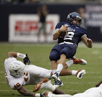 HOUSTON - SEPTEMBER 04:  Running back Sam McGuffie #2 of the Rice Owls is tripped up by safety Kenny Vaccaro #16 of the Texas Longhorns at Reliant Stadium on September 4, 2010 in Houston, Texas. Texas beat Rice 34-17.  (Photo by Bob Levey/Getty Images)