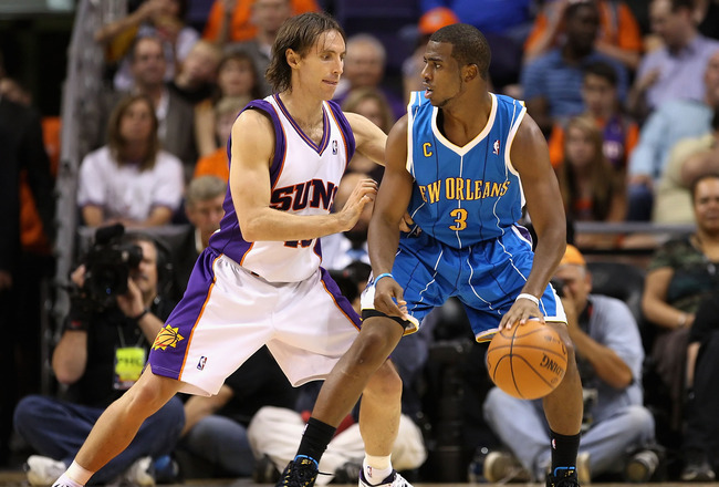 PHOENIX - NOVEMBER 11:  Chris Paul #3 of the New Orleans Hornets handles the ball under pressure from Steve Nash #13 of the Phoenix Suns during the NBA game at US Airways Center on November 11, 2009 in Phoenix, Arizona. NOTE TO USER: User expressly acknow