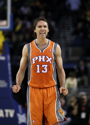 OAKLAND, CA - DECEMBER 02:  Steve Nash #13 of the Phoenix Suns reacts after the Suns made a basket against the Golden State Warriors at Oracle Arena on December 2, 2010 in Oakland, California. NOTE TO USER: User expressly acknowledges and agrees that, by