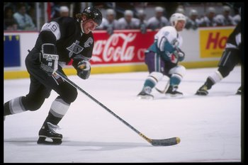 9 Apr 1995: Center Wayne Gretzky of the Los Angeles Kings moves the puck during a game against the Anaheim Mighty Ducks at Arrowhead Pond in Anaheim, California. The Mighty Ducks won the game, 5-1.