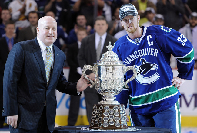 VANCOUVER, CANADA - MAY 24:  NHL Deputy Commissioner Bill Daly and Captain Henrik Sedin #33 of the Vancouver Canucks pose with the Clarence Campbell Bowl after the Vancouver Canucks defeated the San Jose Sharks 3-2 in double-overtime in Game Five to win t