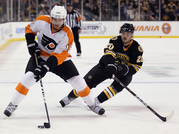 BOSTON, MA - DECEMBER 11:  Andres Nodl #15 of the Philadelphia Flyers takes the puck as Daniel Paille #20 of the Boston Bruins defends on December 11, 2010 at the TD Garden in Boston, Massachusetts.  (Photo by Elsa/Getty Images)