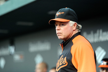 BALTIMORE, MD - AUGUST 10:  Manager Buck Showalter #26 of the Baltimore Orioles watches the game against the Chicago White Sox at Oriole Park at Camden Yards on August 10, 2011 in Baltimore, Maryland.  (Photo by Greg Fiume/Getty Images)