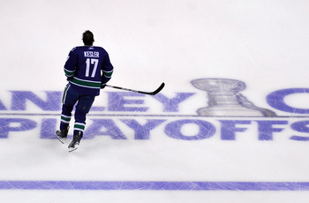 VANCOUVER, CANADA - MAY 24:  Ryan Kesler #17 of the Vancouver Canucks skates during warm-up prior to Game Five of the Western Conference Finals against the San Jose Sharks during the 2011 Stanley Cup Playoffs at Rogers Arena on May 24, 2011 in Vancouver,