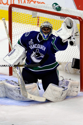 VANCOUVER, BC - JUNE 10:  Roberto Luongo #1 of the Vancouver Canucks makes a glove save against the Boston Bruins during Game Five of the 2011 NHL Stanley Cup Final at Rogers Arena on June 10, 2011 in Vancouver, British Columbia, Canada.  (Photo by Rich L