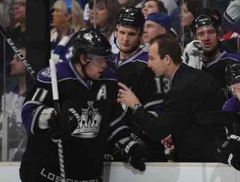 LOS ANGELES, CA - JANUARY 10:  Assistant coach Jamie Kompon gives last minute instructions to Anze Kopitar #11 of the Los Angeles Kings in their game against the Toronto Maple Leafs at the Staples Center on January 10, 2011 in Los Angeles, California. The
