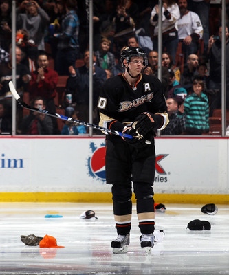 ANAHEIM, CA - JANUARY 12:  Corey Perry #10 of the Anaheim Ducks stands amongst the hats following a hattrick by teammate Bobby Ryan #9 (not shown) against the St. Louis Blues at the Honda Center on January 12, 2011 in Anaheim, California. The Ducks defeat
