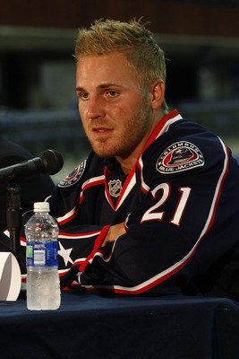 COLUMBUS,OH - JULY 21:  James Wisniewski #21 of the Columbus Blue Jackets fields questions during a press conference on July 21, 2011 at Nationwide Arena in Columbus, Ohio.  (Photo by John Grieshop/Getty Images)