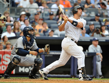 NEW YORK, NY - AUGUST 13: Jorge Posada #20 of the New York Yankees watches his grand slam in the bottom of the fifth inning against the Tampa Bay Rays at Yankee Stadium on August 13, 2011 in the Bronx borough of New York City. (Photo by Christopher Pasati