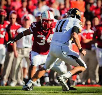 LINCOLN, NE - OCTOBER 30: Defensive end Cameron Meredith #34 of the Nebraska Cornhuskers closes in on  quarterback Blaine Gabbert #11of the Missouri Tigers during first half action of their game at Memorial Stadium on October 30, 2010 in Lincoln, Nebraska