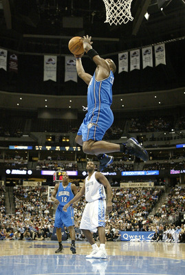 DENVER - DECEMBER 6:  Steve Francis #3 of the Orlando Magic spins as he dunks against the Denver Nuggets in the first half on December 6, 2004 at the Pepsi Center in Denver, Colorado.  NOTE TO USER: User expressly acknowledges and agrees that, by download