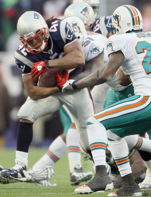FOXBORO, MA - JANUARY 02:  BenJarvus Green-Ellis #42 of the New England Patriots carries the ball as Tim Robbins #51 of the Miami Dolphins defends on January 2, 2011 at Gillette Stadium in Foxboro, Massachusetts.  (Photo by Elsa/Getty Images)