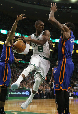 BOSTON, MA - APRIL 19:  Rajon Rondo #9 of the Boston Celtics looks to pass as Amare Stoudemire #1 and Toney Douglas #23 of the New York Knicks defend in Game Two of the Eastern Conference Quarterfinals in the 2011 NBA Playoffs on April 19, 2011 at the TD