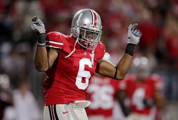 COLUMBUS, OH - SEPTEMBER 12:  Linebacker Etienne Sabino #6 of the Ohio State Buckeyes celebrates after stopping C.J. Gable #2 of the USC Trojans (not pictured) during the first quarter of the game at Ohio Stadium on September 12, 2009 in Columbus, Ohio. (