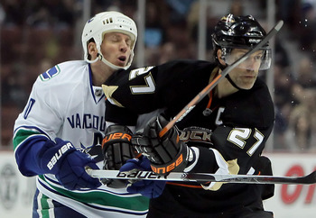 ANAHEIM, CA - APRIL 02:  Ryan Johnson #10 of the Vancouver Canucks is elbowed by Scott Niedermayer #27 of the Anaheim Ducks in the first period at the Honda Center on April 2, 2010 in Anaheim, California.  (Photo by Jeff Gross/Getty Images)