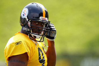 LATROBE, PA - JULY 29:  James Harrison #92 of the Pittsburgh Steelers snaps in his chin guard during training camp on July 29, 2011 at St Vincent College in Latrobe, Pennsylvania.  (Photo by Jared Wickerham/Getty Images)