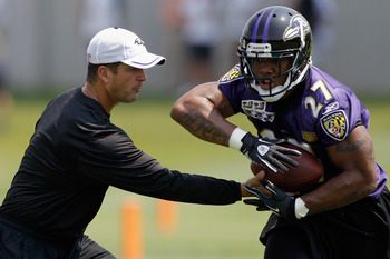 OWINGS MILLS, MD - JULY 29: Head coach John Harbaugh hands the ball off to running back Ray Rice #27 of the Baltimore Ravens during training camp on July 29, 2011 in Owings Mills, Maryland.  (Photo by Rob Carr/Getty Images)