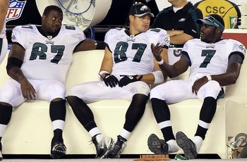 PHILADELPHIA, PA - AUGUST 11:  Michael Vick #7, Jamaal Jackson #67 and Brent Celek #87 of the Philadelphia Eagles look on from the bench against the Baltimore Ravens during their pre season game on August 11, 2011 at Lincoln Financial Field in Philadelphi