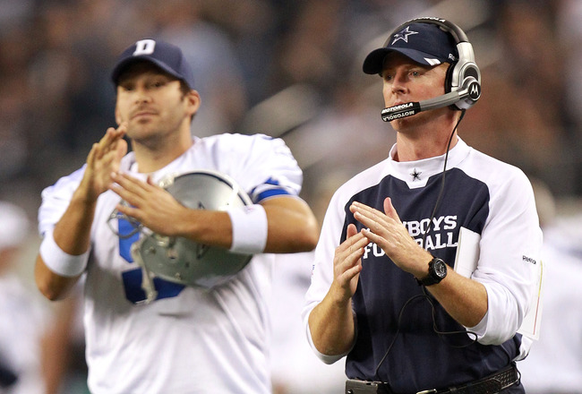 ARLINGTON, TX - AUGUST 11:  Head coach Jason Garrett and Tony Romo #9 of the Dallas Cowboys at Cowboys Stadium on August 11, 2011 in Arlington, Texas.  (Photo by Ronald Martinez/Getty Images)