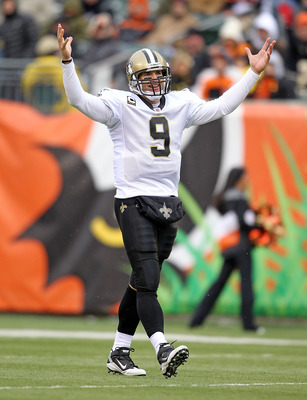 CINCINNATI, OH - DECEMBER 05:  Dree Brees #9 of the New Orleans Saints celebrates after a touchdown during the NFL game against the Cincinnati Bengals at Paul Brown Stadium on December 5, 2010 in Cincinnati, Ohio.  The Saints won 34-30.  (Photo by Andy Ly