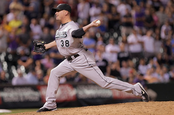 DENVER, CO - AUGUST 15:  Relief pitcher Randy Choate #38 of the Florida Marlins delivers against Jason Giambi #23 of the Colorado Rockies in the ninth inning at Coors Field on August 15, 2011 in Denver, Colorado. Choate gave up the game winning homerun to