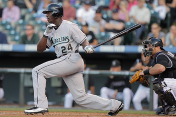 DENVER, CO - AUGUST 16:  Mike Cameron #24 of the Florida Marlins hits a two RBI double off of starting pitcher Jhoulys Chacin #45 of the Colorado Rockies to give the Marlins a 3-0 lead over the Rockies in the first inning at Coors Field on August 16, 2011